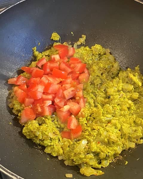 Base sauce, coloured onion and tomato cooking