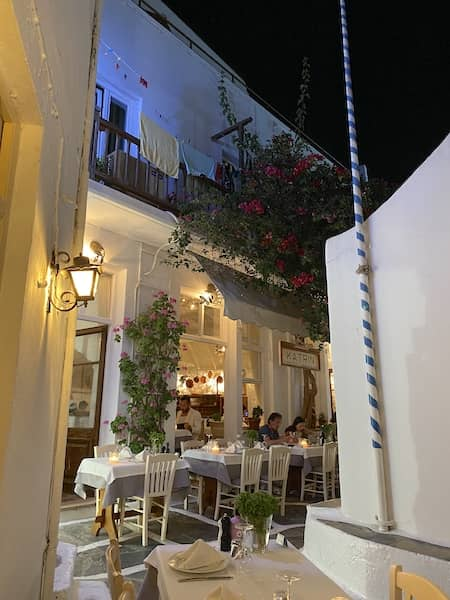 Restaurant in a narrow street in Chora