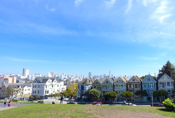 The iconic Victorian houses aka The Painted Ladies with downtown san Francisco in the background