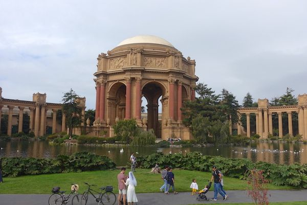 The Palace of Fine Arts and newly weds with a bicycle