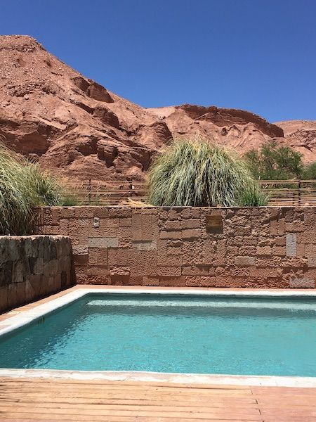 swimming pool with the desert in the back