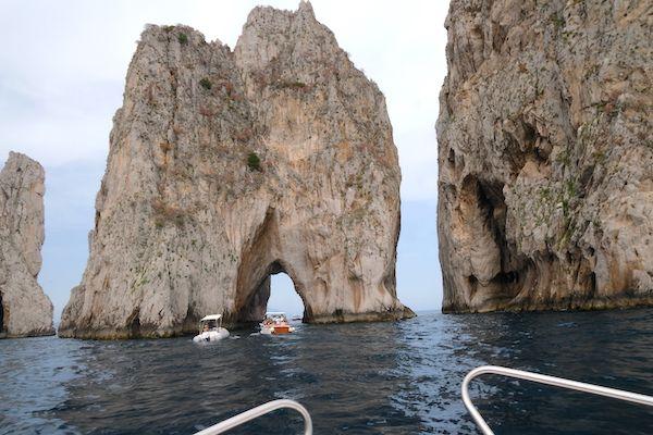 going under the Faraglioni sea stacks
