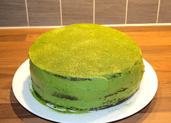 Dark Chocolate & Matcha Cream Cake with a naked look on the sides