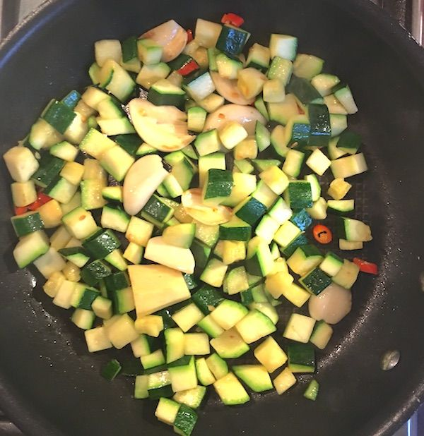 courgettes cooking in the sauce pan