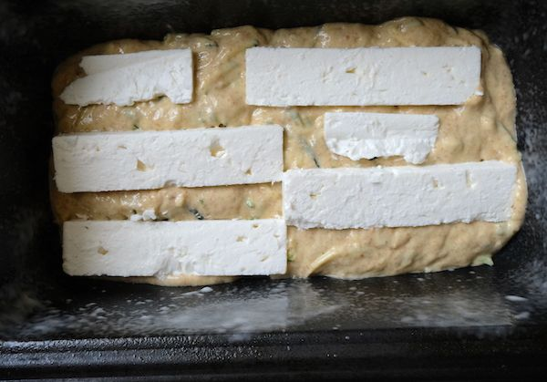 mould with half the batter and goat cheese slices on top