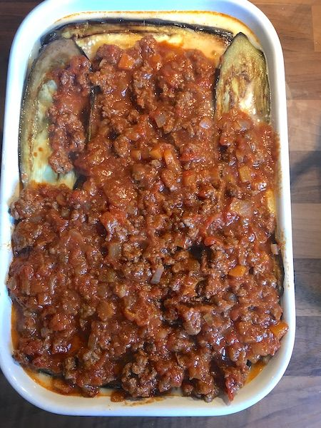 meat ragu on top of aubergines