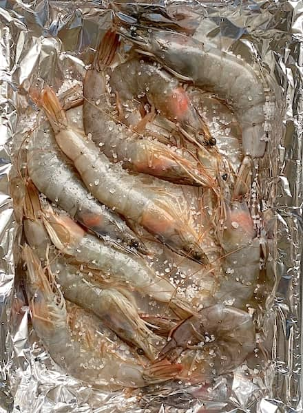raw prawns marinating with coarse sea salt