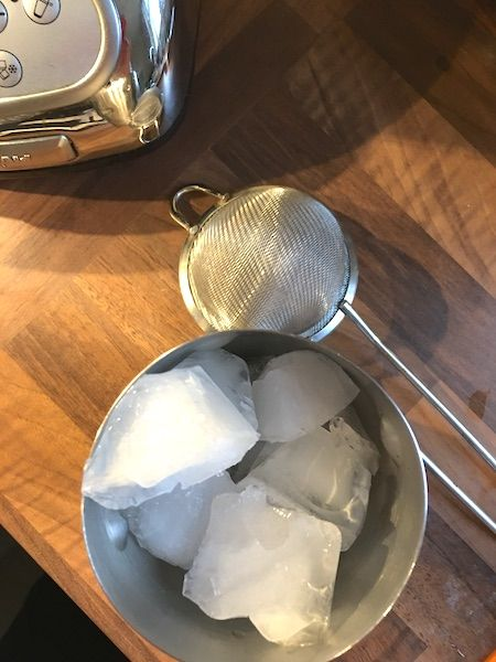 strainer, shaker with ice and corner of blender