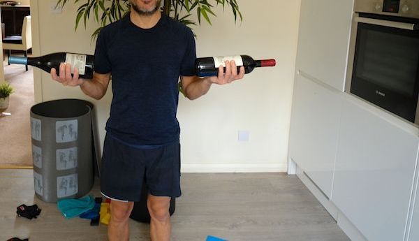 Using wine bottles to do bicep work